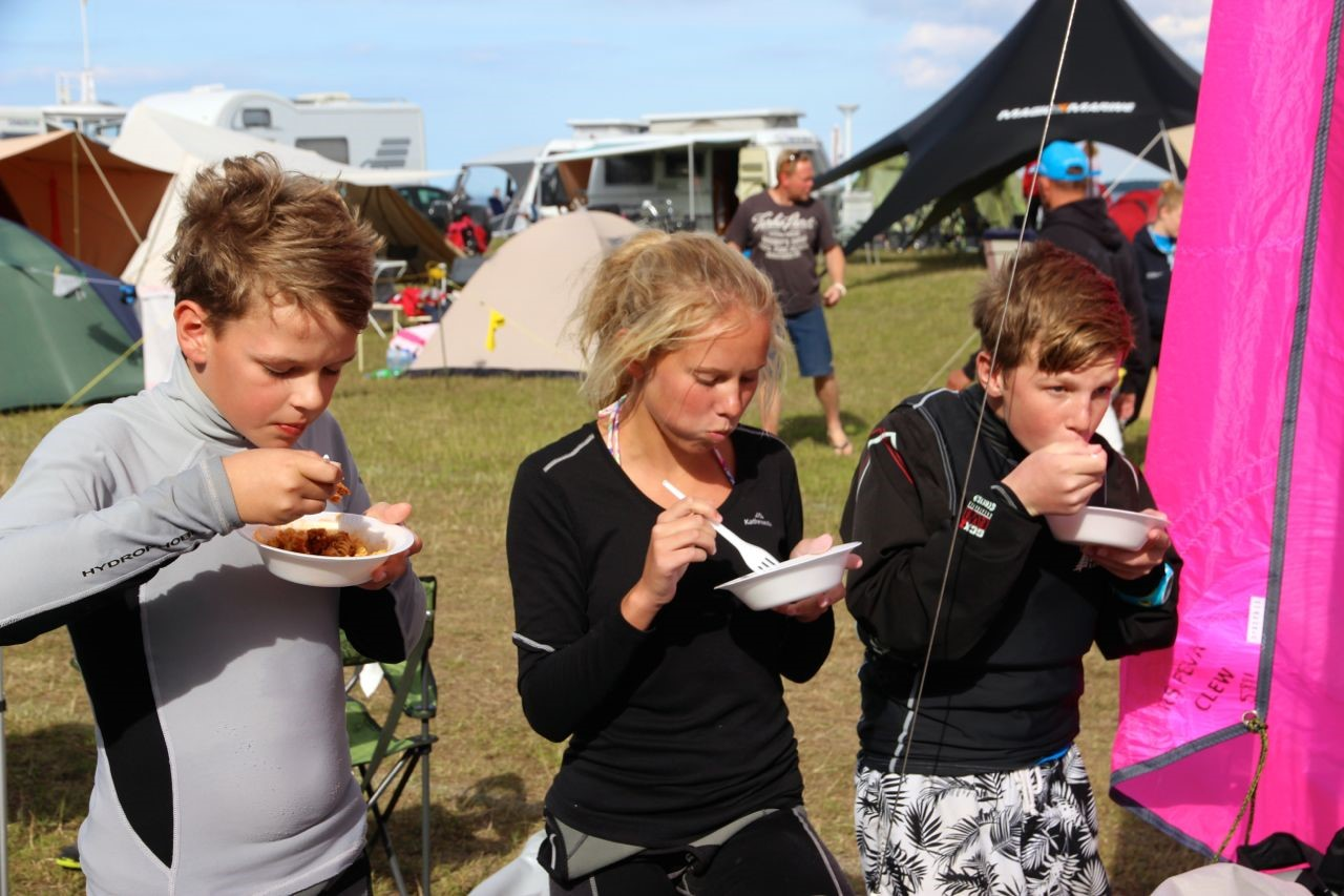 The team nourishing themselves after trying conditions on day two of the Feva Worlds