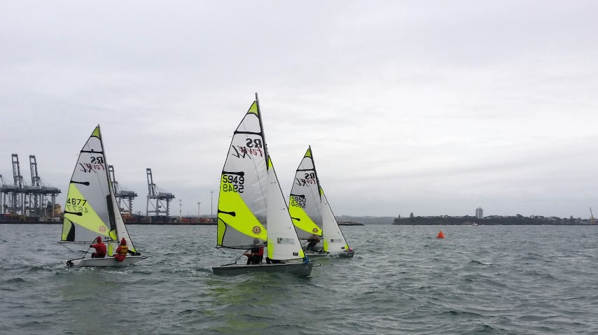 Junior sailors trying out a port tack start