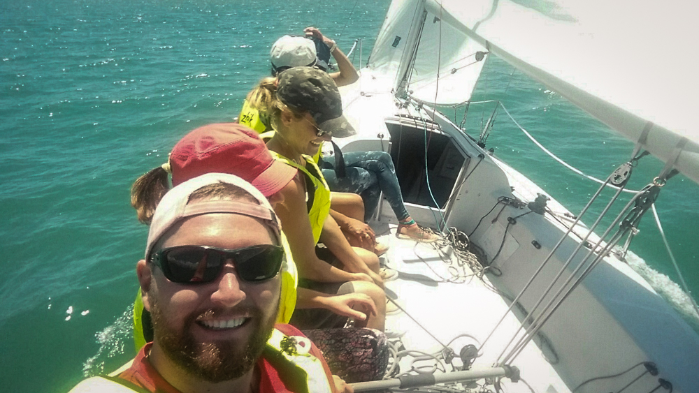 Coach Nathan teaching an adult learn to sail class.