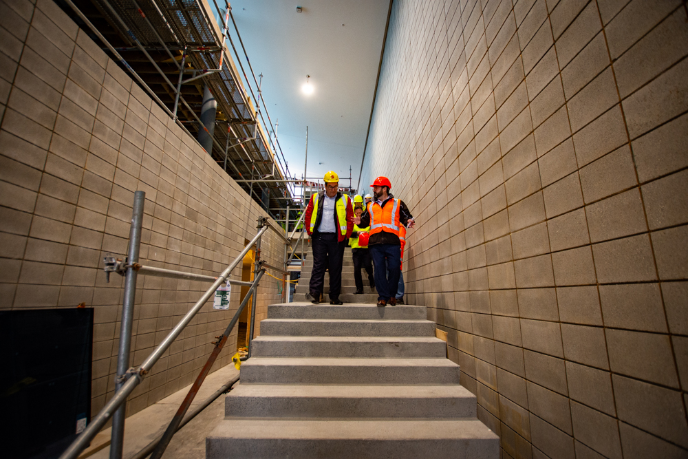 Hon Grant Robertson and Andrew Brookland walk down the main stairs
